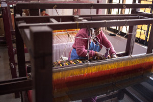 A woman weaves dhaka fabric by hand in Nepal | Where in the World Apparel